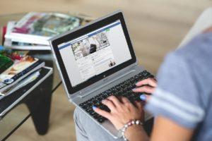 woman on facebook on laptop